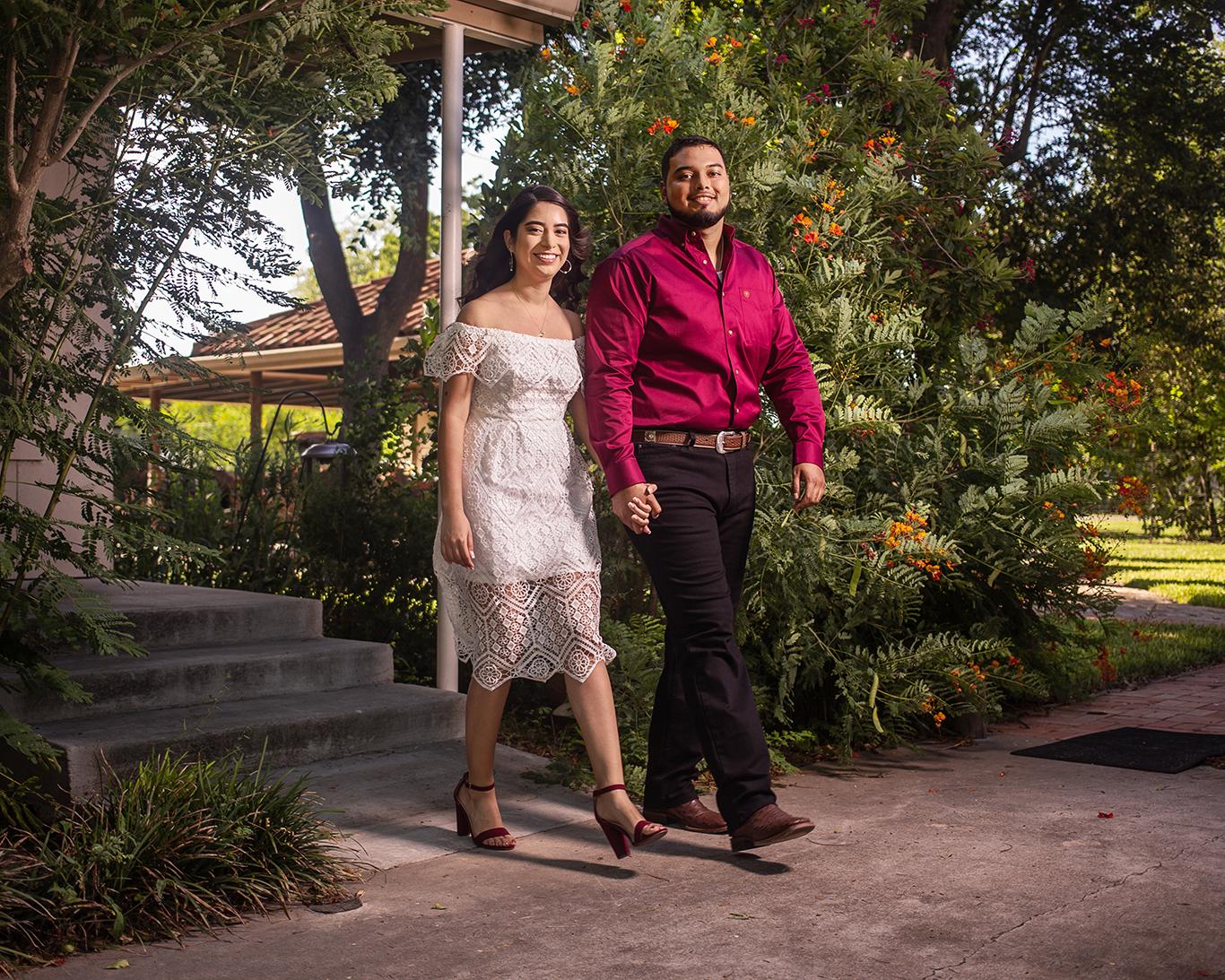 engagement portrait couple walking smiling