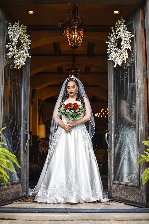 bride looking down at door