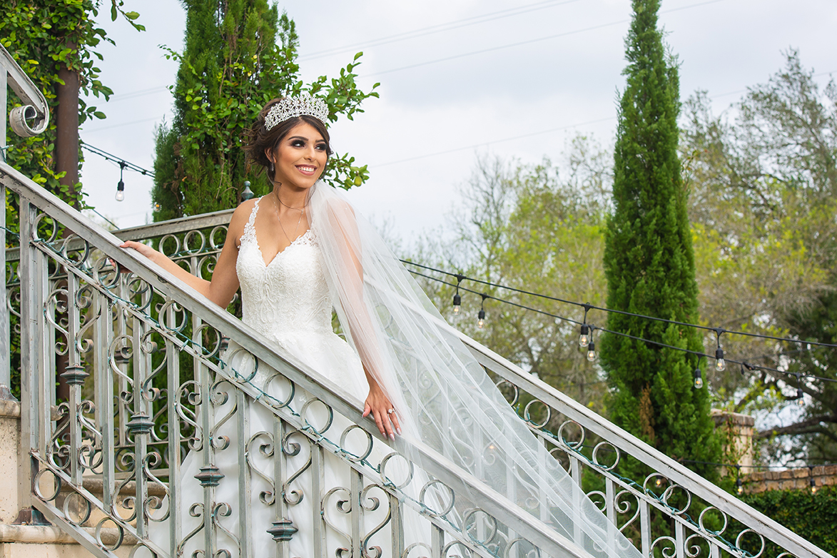 bride on staircase looking away